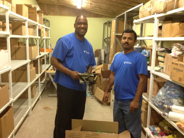 Willie Ford and Tirumala Raju organize our storage room